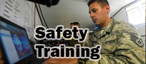 Safety training graphic depicting military member taking online training.
